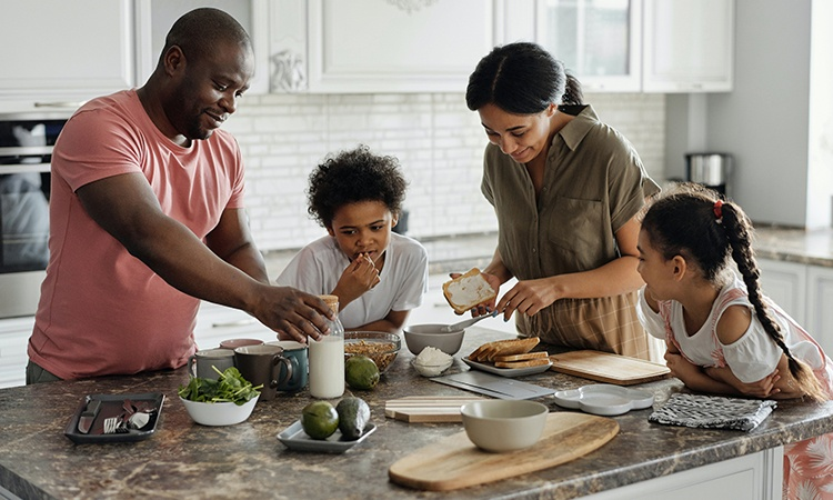Immigrant family together in the kitchen